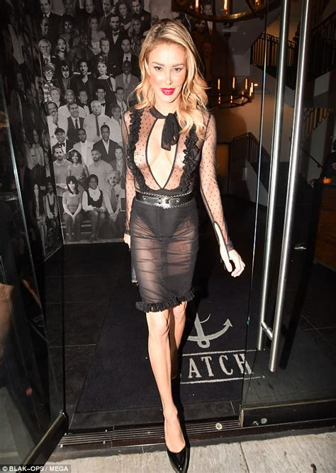 Brandi Glanville flashes the flesh in a sheer dress in LA