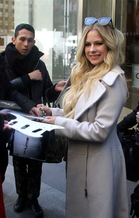 Avril Lavigne in a White Coat Was Seen Out in NYC 02/19